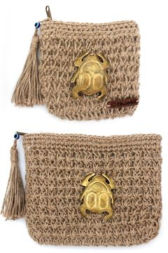 """Picture of Our """"Grab and Go"""" collection featuring the sacred scarab of Ancient Egypt, a symbol of regeneration. Attached to the crochet burlap pouches.Small"""