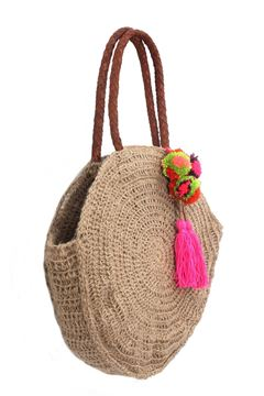 "Picture of ""Round and round we go again"" crochet bag with leather handle. A pop of color is always a good idea with our handmade tassel and pompoms."