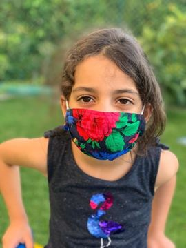 Picture of  Floral Mask with elastic bands for kids. -  Note: Color will vary depending on the material available.  - Our masks are composed of 3 layers including a filter and a nose support.